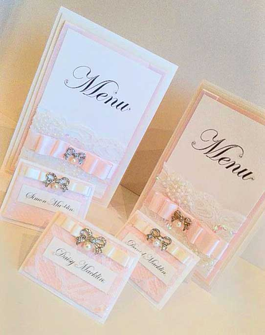 Baby pink satin & white lace with bow embellishment name place cards & menu collection