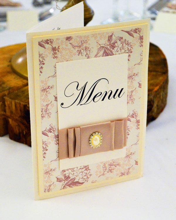 Elegant floral overlay on ivory card with coffee satin bow wedding table menu