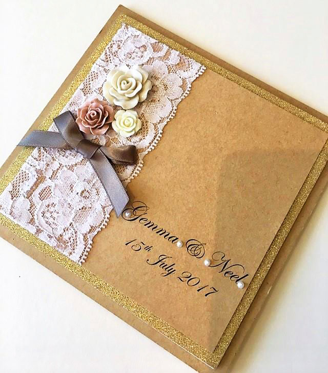 Card edged with champagne glitter with vintage blush roses and lace trim