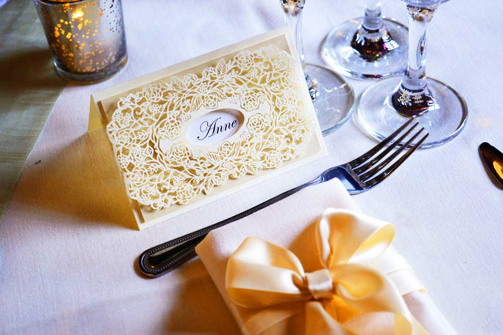 Ivory laser cut name place card and matching napkin dressing