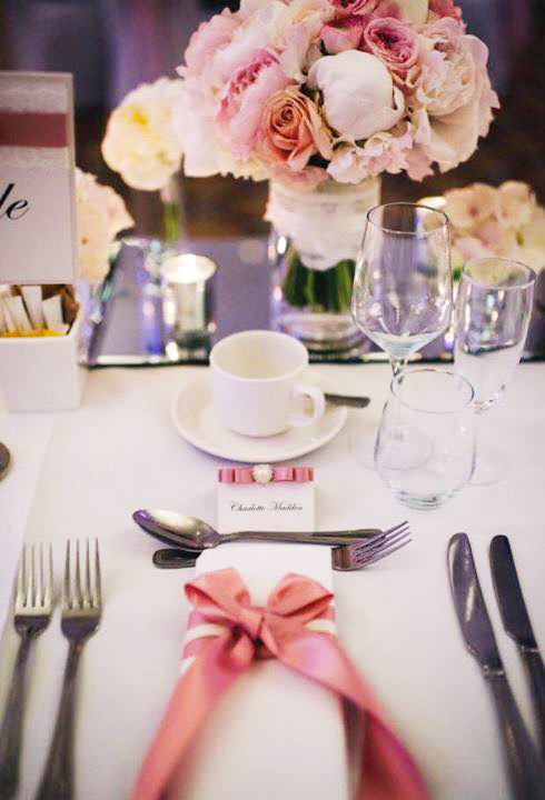 Dusky pink satin bow napkin dressing & name place card