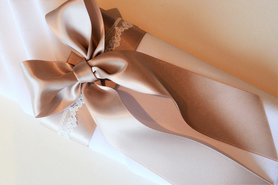 Napkin dressing with satin bow & white lace
