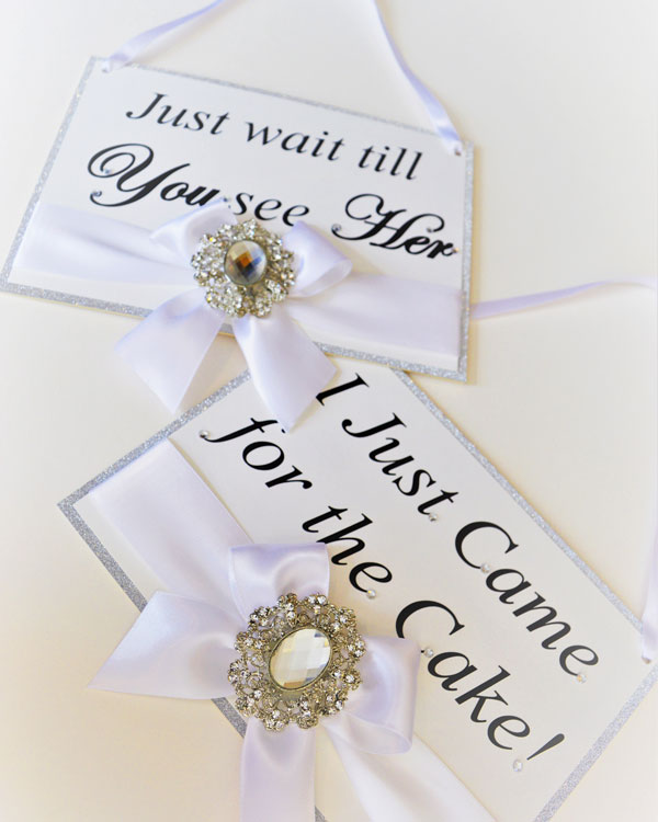 Cute page boy & flower girl signs with white satin bow