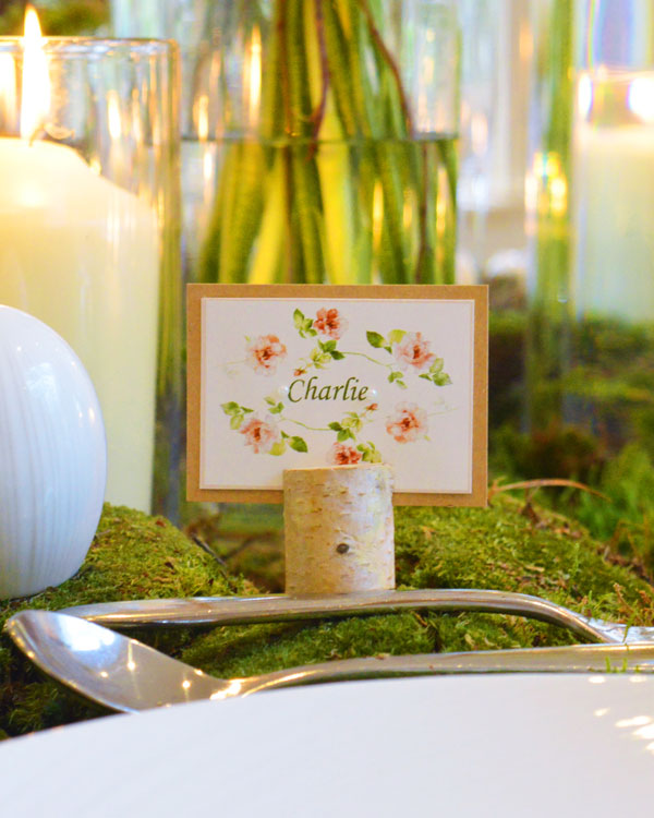 Rustic style name place card, mounted on craft card with floral detail & pearls. Wooden tree stump holder
