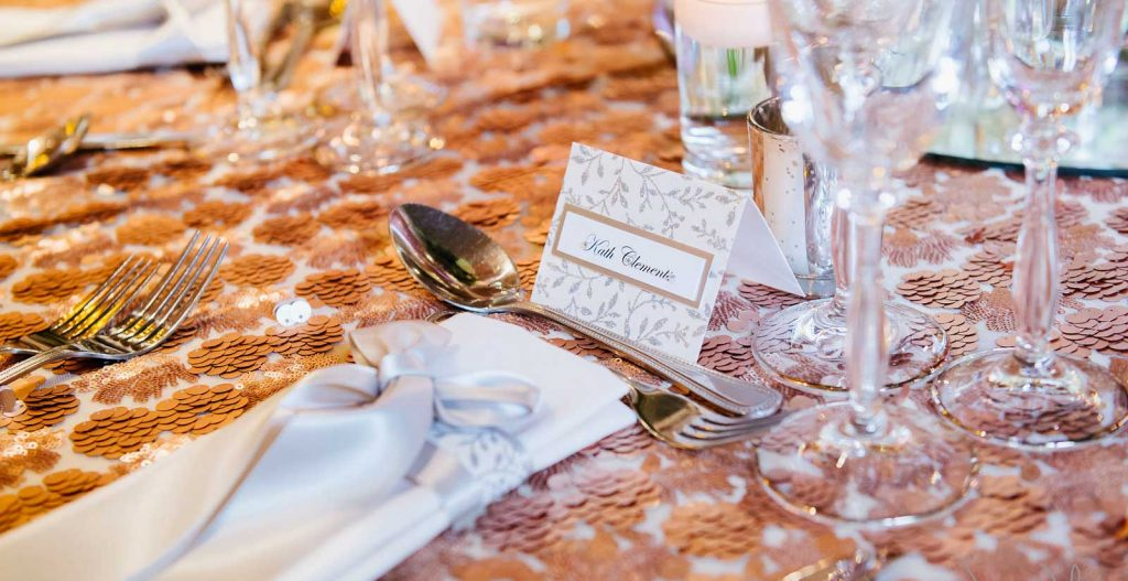 Silver leaf name place cards and napkin dressing by Charlotte Designs