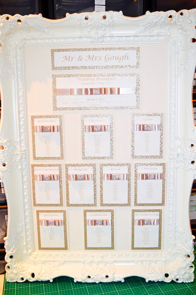 White Victorian framed table plan with satin pleated ribbon & diamante embellishment