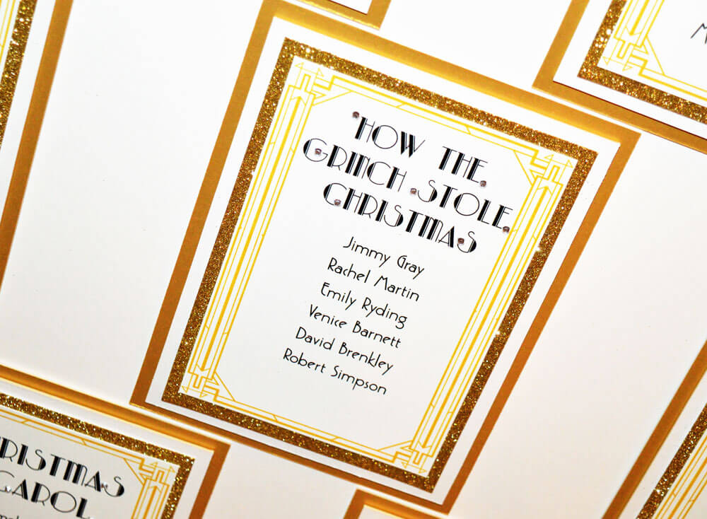 Close up of gold art deco themed wedding table plan design