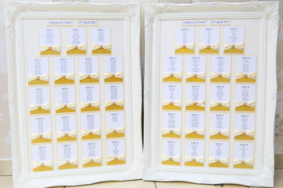 Framed table plan with opulent gold sparkle card, pearl diamante heart brooch and ivory satin ribbon