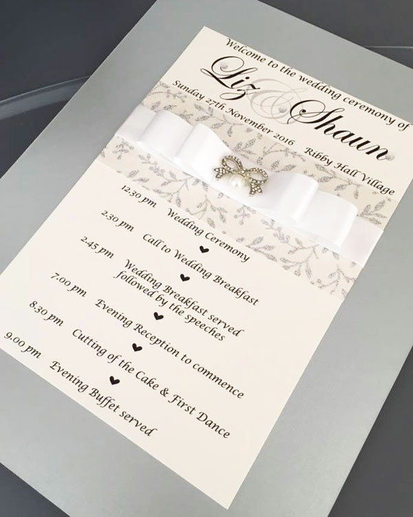Silver grey and white satin bow wedding Order of Ceremony with sparkly silver leaf design by Charlotte Designs