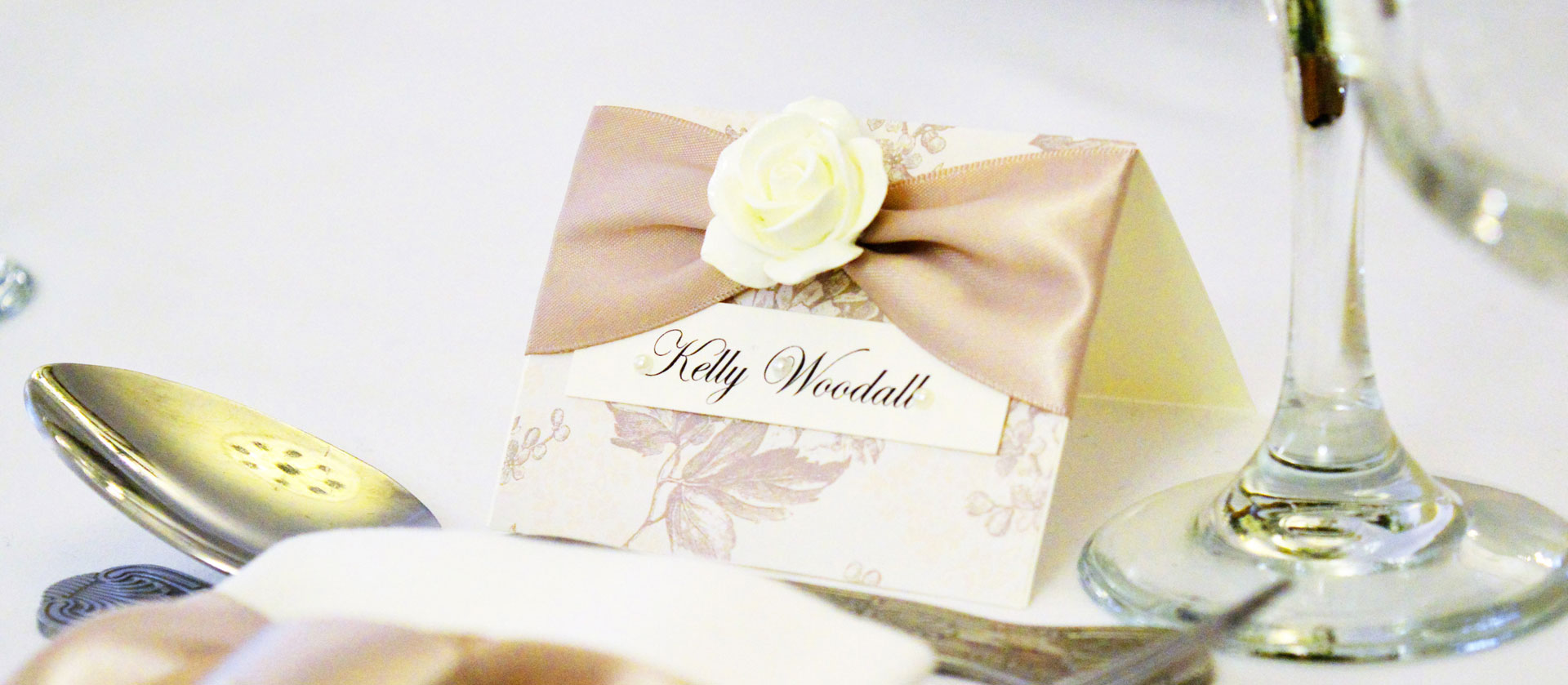Beautiful handmade ivory rose, floral printed card and satin ribbon name place cards by Charlotte Designs