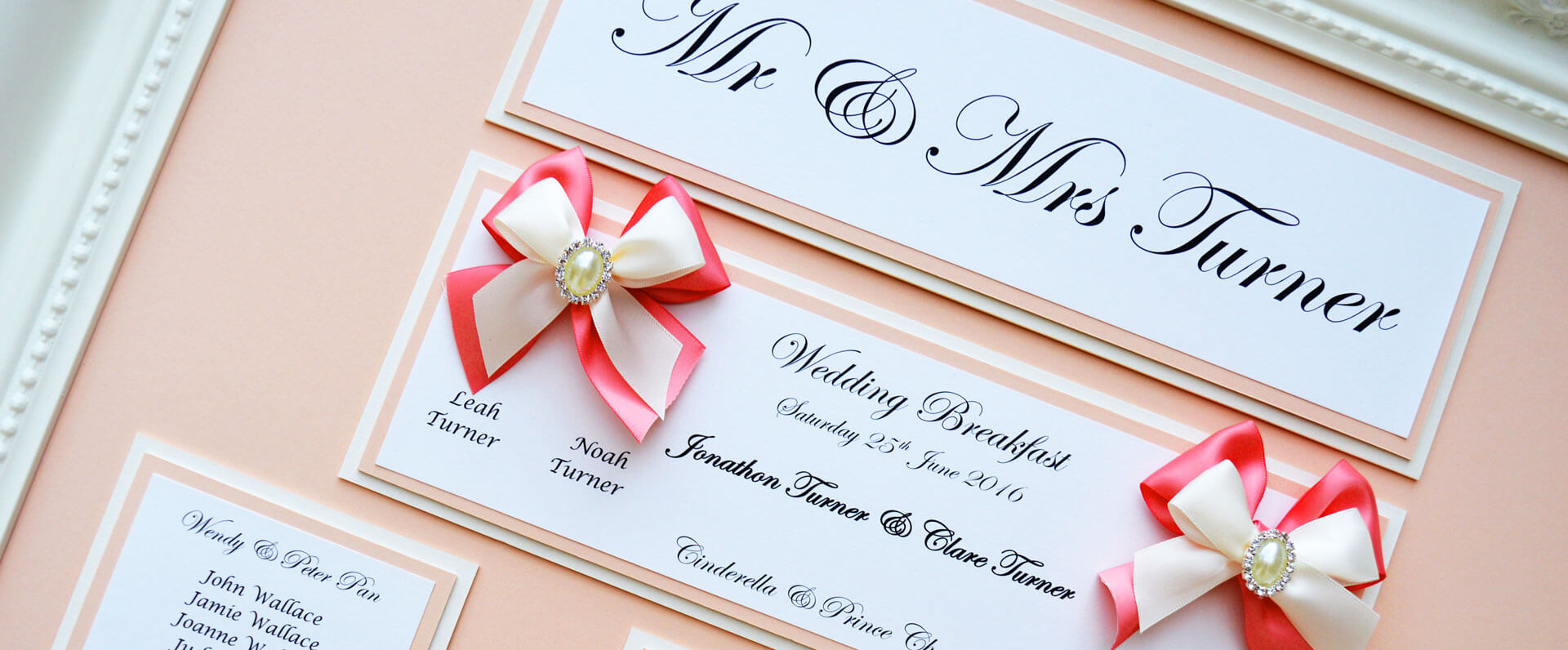 Pink wedding table plan with white Victorian frame by Charlotte Designs